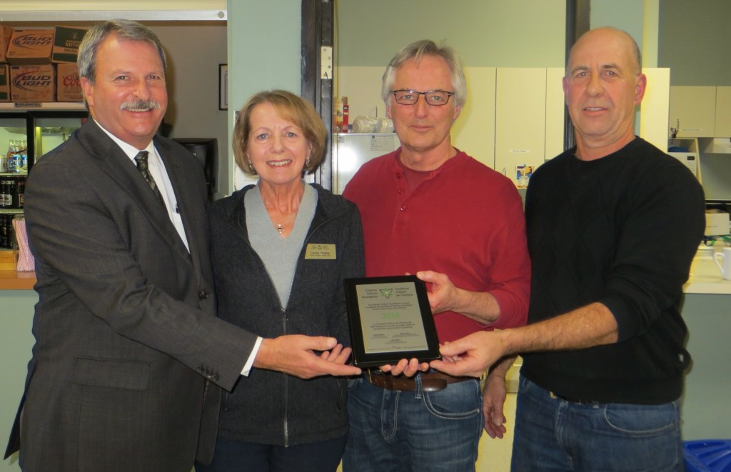 Pictured (left-to-right): Jack MacLaren, MPP – Carleton Mississippi Mills, Louise Heslop – Ontario Trillium Foundation, Bob Farmer – President, ACC, Art McKay – Ice Manager, ACC Photo by Carolyn Mountenay